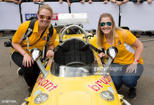 Meagan and Lauren McKinney pose beside Michael McKinney's 1967 Indy Race Car the Vollstedt Ford Bryant Cooling in the Assembly Area during the...
