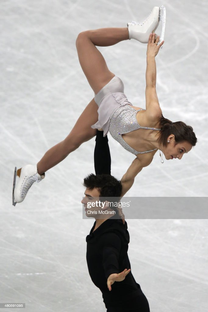 <a gi-track='captionPersonalityLinkClicked' href=/galleries/search?phrase=Meagan+Duhamel&family=editorial&specificpeople=2076875 ng-click='$event.stopPropagation()'>Meagan Duhamel</a> and <a gi-track='captionPersonalityLinkClicked' href=/galleries/search?phrase=Eric+Radford&family=editorial&specificpeople=5587908 ng-click='$event.stopPropagation()'>Eric Radford</a> of Canada compete in the Pairs Short Program during ISU World Figure Skating Championships at Saitama Super Arena on March 26, 2014 in Saitama, Japan.