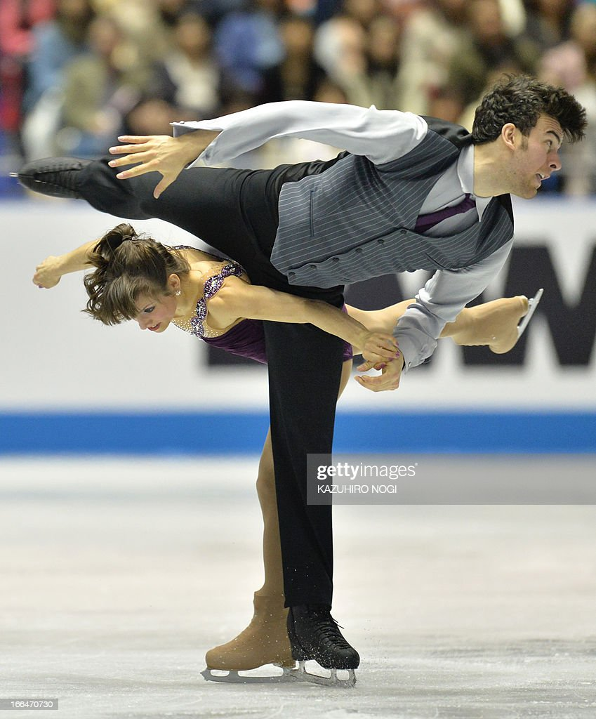 Meagan Duhamel (bottom) and Eric Radford (top) of Canada perform in the pairs free skating event at the World Team Trophy figure skating competition in Tokyo on April 13, 2013.