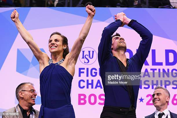 Meagan Duhamel and Eric Radford of Canada react after hearing their score in the Pairs Free Skate on Day 6 of the ISU World Figure Skating...