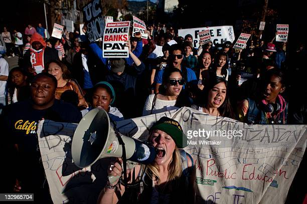 Meagan Moroney leads University of California Berkeley students on a march through Berkeley as part of an 'open university' strike in solidarity with...