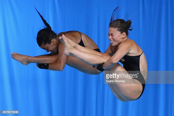 Meaghan Benfeito and Roseline Filion of Canada compete in the Women's Synchronised 10m Platform Final at Royal Commonwealth Pool during day seven of...