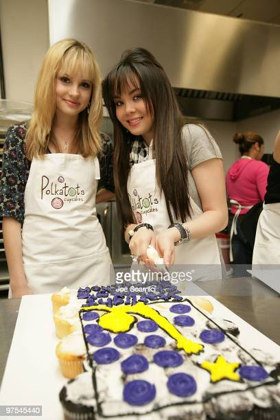 Meaghan Martin and Anna Maria Perez de Tagle making cupcakes for the Polkatots Cupcakes celebrity launch party honoring children from Camp Ronald...