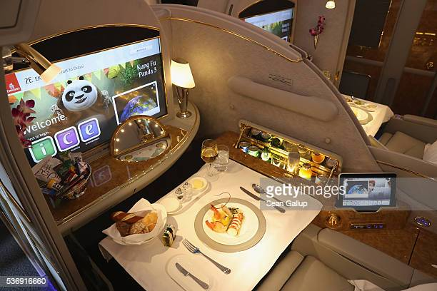 A meal lies served in a compartment in first class on board an Emirates A380 passenger plane at the ILA 2016 Berlin Air Show on June 1 2016 in...