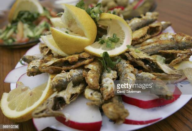 A meal of fried sardines is served in a restaurant in the local produce market February 22 2006 in Netanya in central Israel Fish which the American...