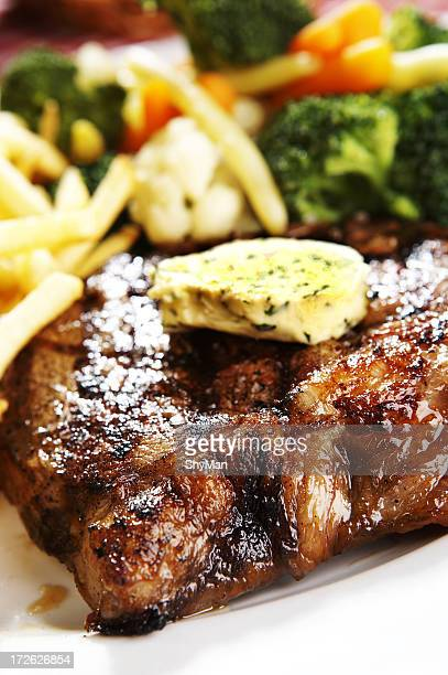 Meal of grilled steak with butter and vegetables