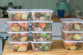 Meal prep. Stack of home cooked roast chicken dinners in containers ready to be frozen for later use as quick and easy ready meals.