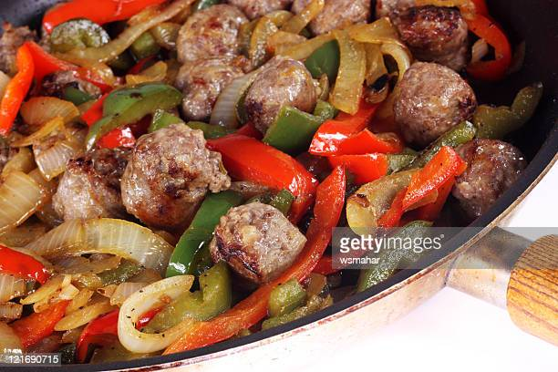 Meal with beef, sausage, onions and peppers