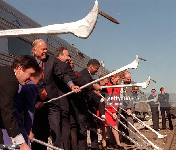 MEAlameda2kl12/10/98––SOUTH GATE––Ho––Elected and appointed local state and federal government officials line up with crowbars to pull spikes from...