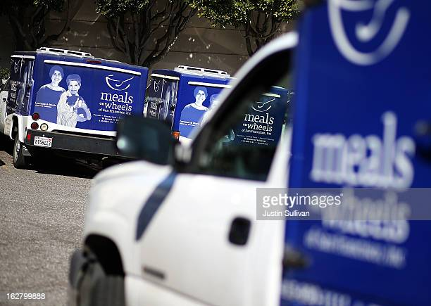 Meals On Wheels of San Francisco sit idle on February 27 2013 in San Francisco California Programs for the poor like Meals On Wheels which delivers...