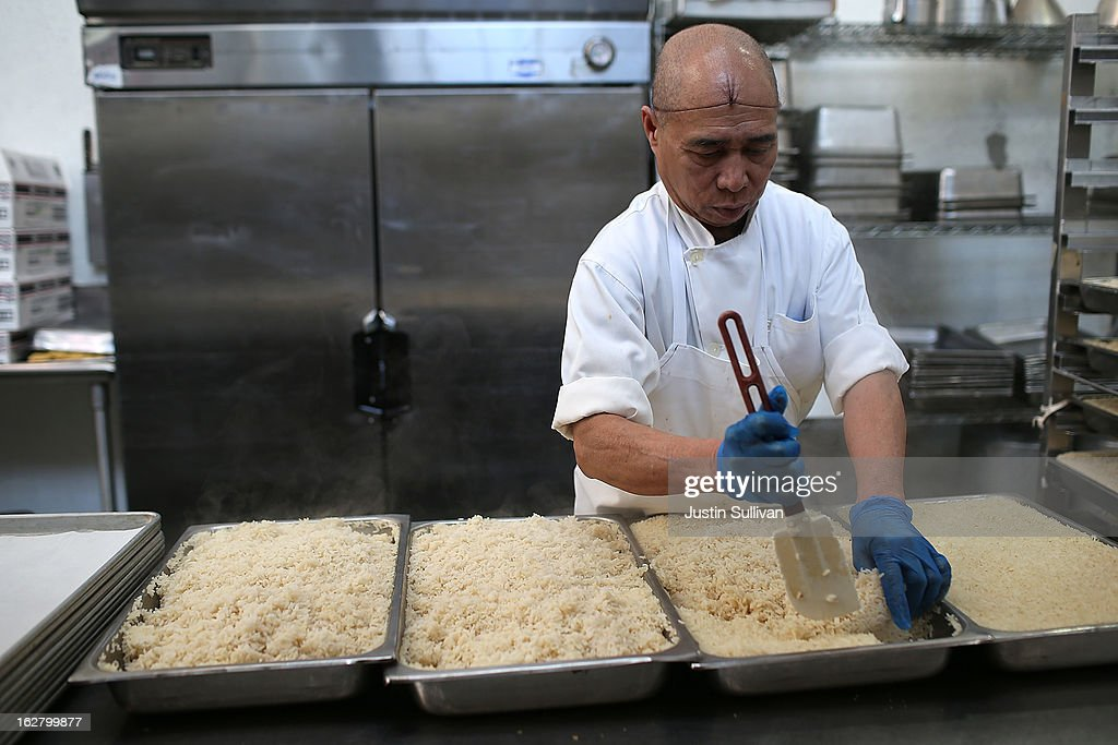 A Meals On Wheels of San Francisco worker prepares trays of rice on February 27, 2013 in San Francisco, California. Programs for the poor like Meals On Wheels, which delivers meals to homebound seniors, could be affected if $85 billion in federal spending cuts come down due to sequestration.