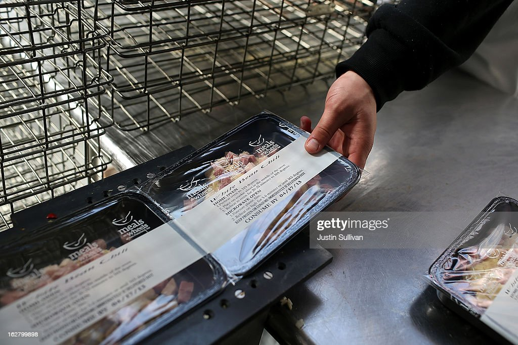 A Meals On Wheels of San Francisco worker takes prepared meals off of a conveyor belt on February 27, 2013 in San Francisco, California. Programs for the poor like Meals On Wheels, which delivers meals to homebound seniors, could be affected if $85 billion in federal spending cuts come down due to sequestration.