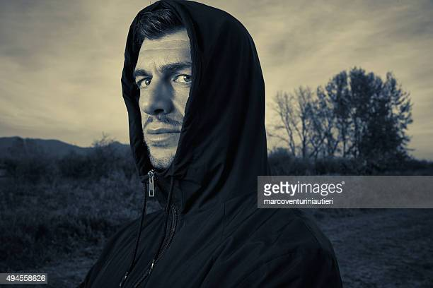Mean hooded man looking at you - be afraid!