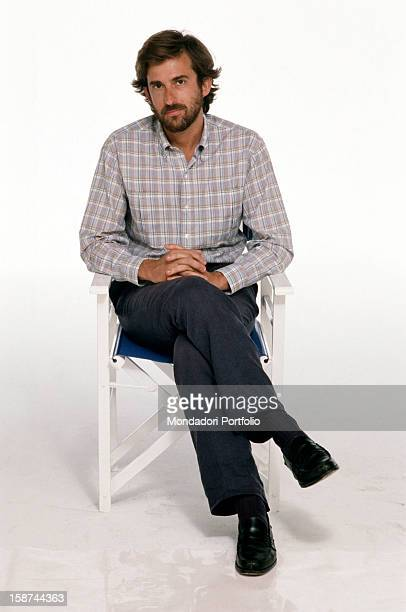 A meaningful wholelength portrait of Italian director and actor Nanni Moretti sitting on a director chair in his movies he portrays social political...