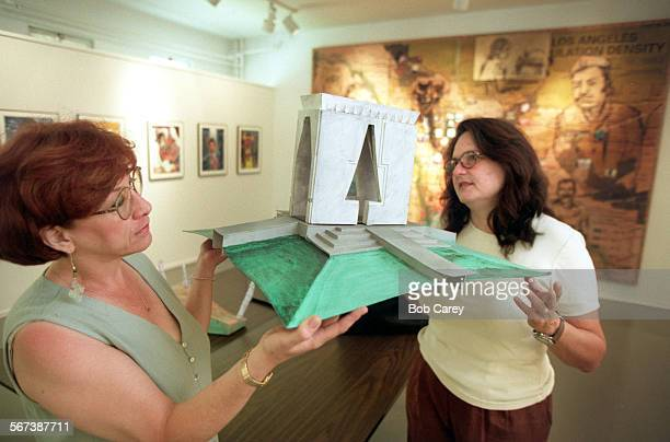 MEArt#20507BC/d–––Gail Schwartz left and Judith F Baca hold up model of Mayan arch by Edgar Aaricio they hope to erect in Alvarado Terrace in Pico...