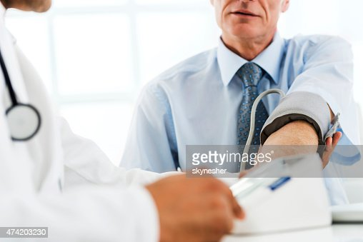 Measuring blood pressure at doctor's office.