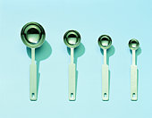 Measuring spoons in row, overhead view