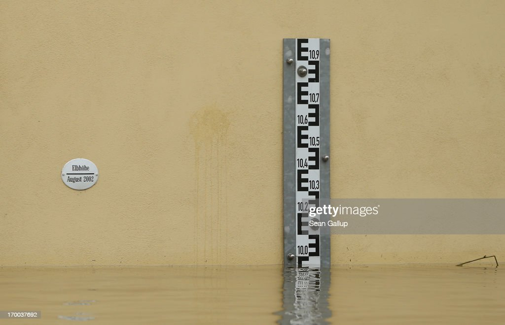 A measuring stick shows the level of floodwaters at just under 10 meters next to a marker that shows the level reached during the 100-year-flood of 2002 in a street flooded by the nearby Elbe river in the historic city center on June 6, 2013 in Meissen, Germany. Eastern and southern Germany are suffering under floods that in some cases are the worst in 400 years. At least four people are dead and tens of thousands have evacuated their homes.