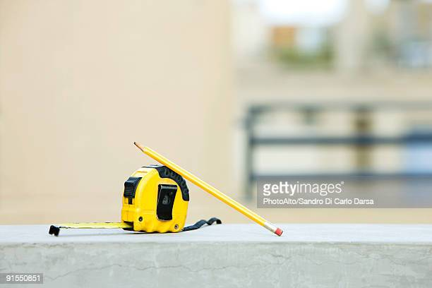 Measuring tape with pencil on ledge
