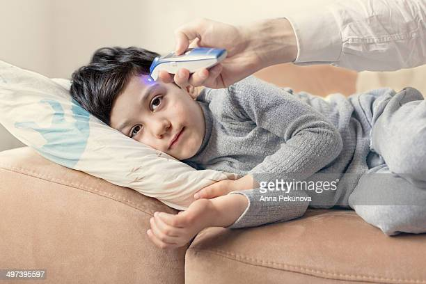 Measuring temperature of sick boy