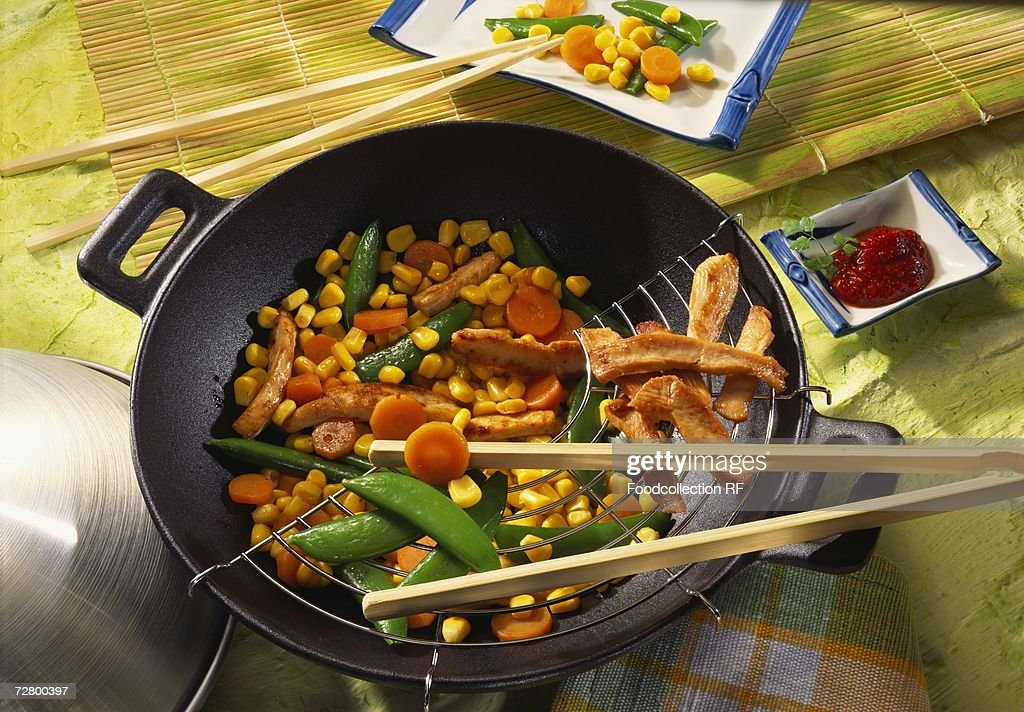 Meat and vegetables in wok : Stock Photo