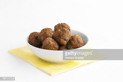 Meat balls in a white bowl, studio shot