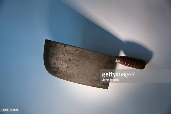 A meat cleaver is displayed after being confiscated at an airport security checkpoint at the JFK International Airport on November 18 2014 in New...