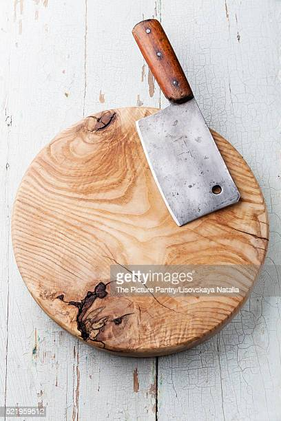 Meat cleaver on blue wooden background
