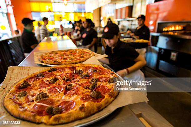 PASADENA CA FEBRUARY 21 2014 Meat Eater pizza on the counter waiting for pick up during lunchtime at BLAZE PIZZA on East Colorado Blvd Friday...