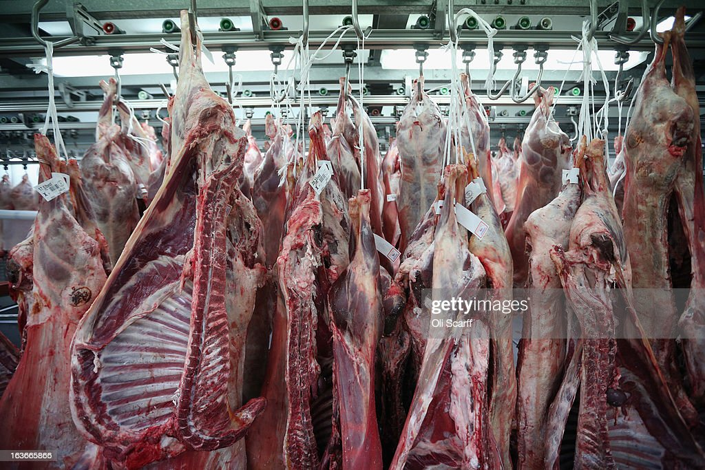 Meat hangs in a butchers stall before being prepared for sale in Smithfield Market on March 14, 2013 in London, England. Smithfield Market, which is officially named the 'London Central Markets', has been the site of a livestock market since the Twelfth Century. Located in the City of London, the market's Victorian buildings were designed by Sir Horace Jones, the City Architect, and were completed in the 1860s. Developers have recently proposed a 160 million GBP refurbishment of the derelict western end of Smithfield Market into an artisan food centre known as 'Smithfield Quarter'.