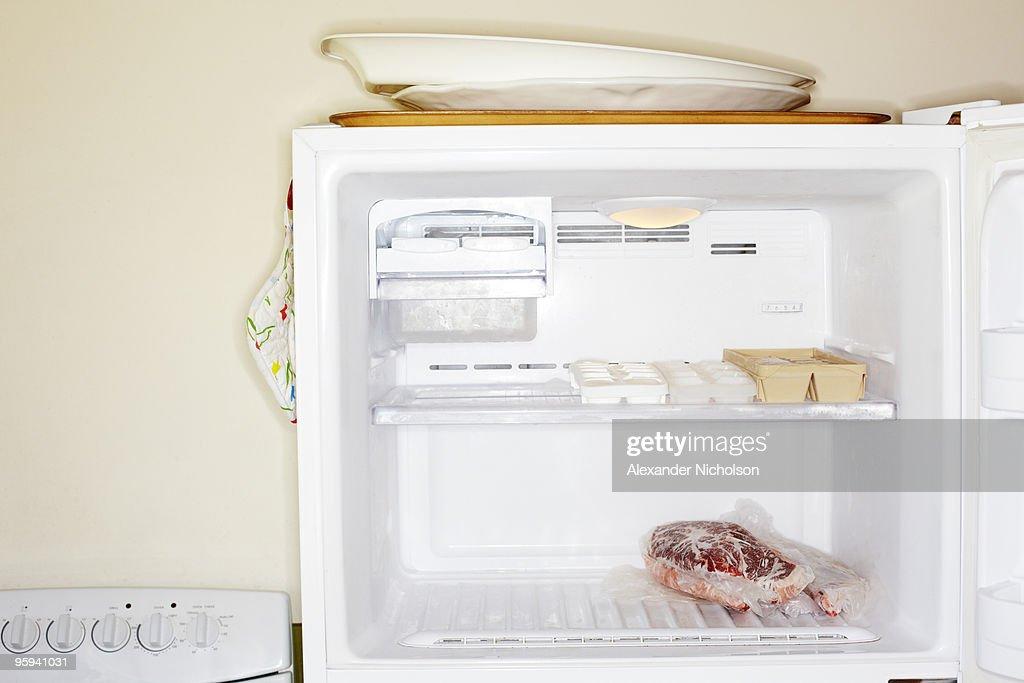 Meat inside open freezer : Stock Photo