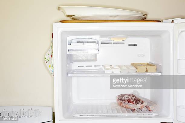 Meat inside open freezer