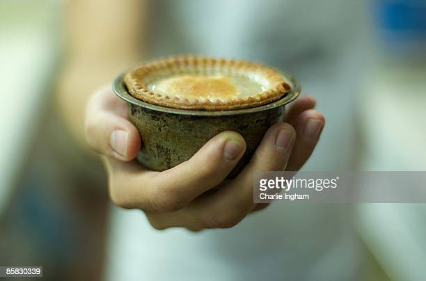 Meat pie uncooked in tin