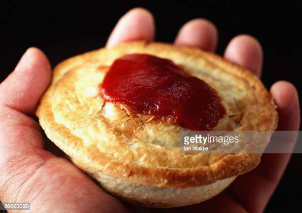 A meat pie with tomato sauce is pictured January 25 2006 in Sydney Australia The meat pie an Australian culinary specialty and icon is the biggest...