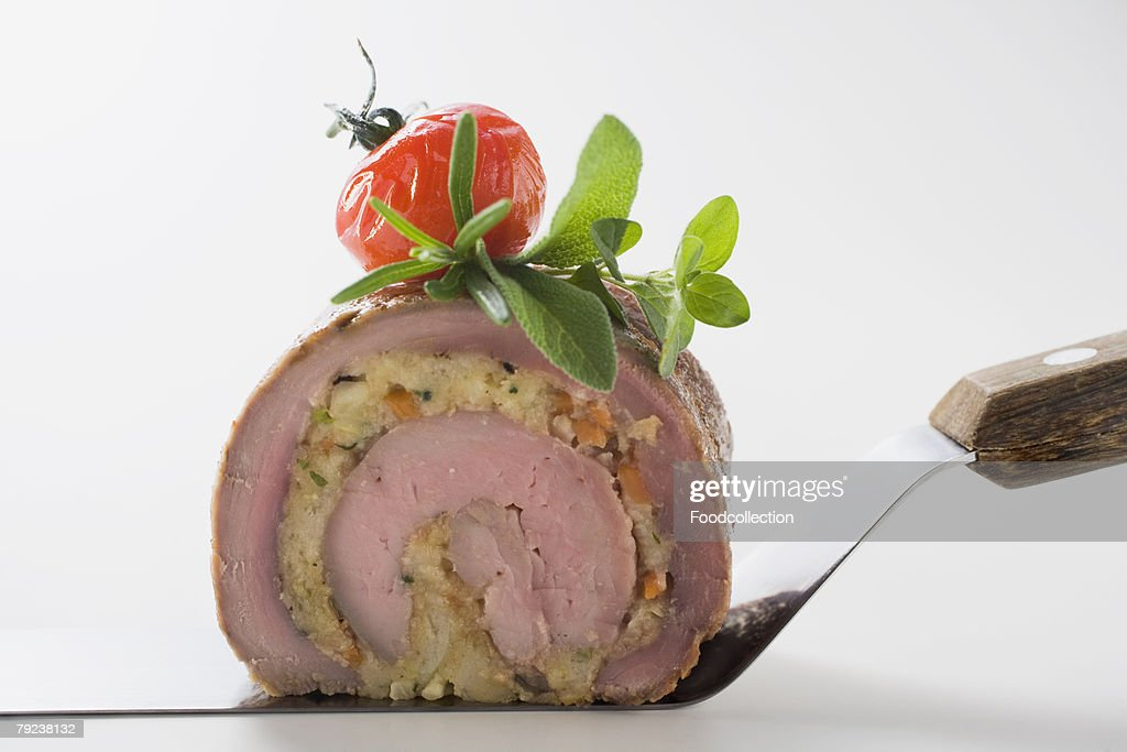 Meat roulade with vegetable and herb stuffing : Stock Photo