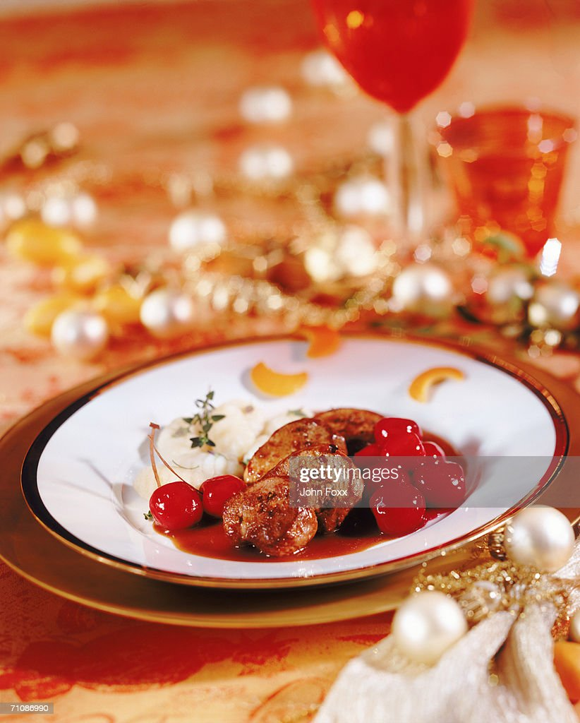 Meat with cheery and wine glass, close-up : Stock Photo