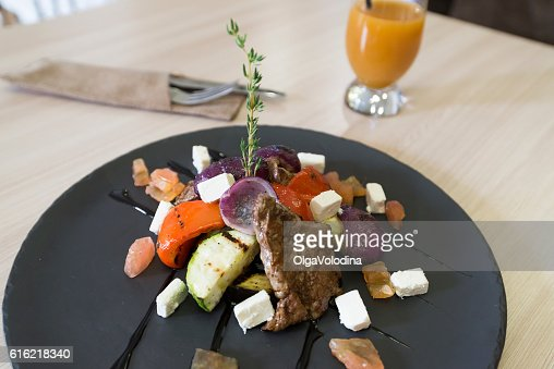 Meat with vegetables and cheese in restaurant : ストックフォト