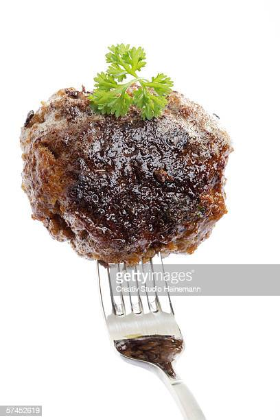 Meatball in fork, close-up