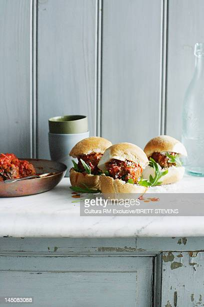 Meatball sandwiches on marble counter