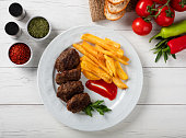 Meatballs and french fries with vegetables