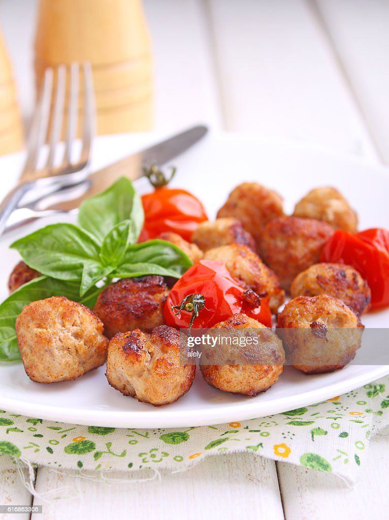 Meatballs with tomato in a white dish : Stock Photo