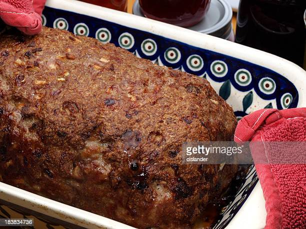 A meatloaf being served hot out of the oven