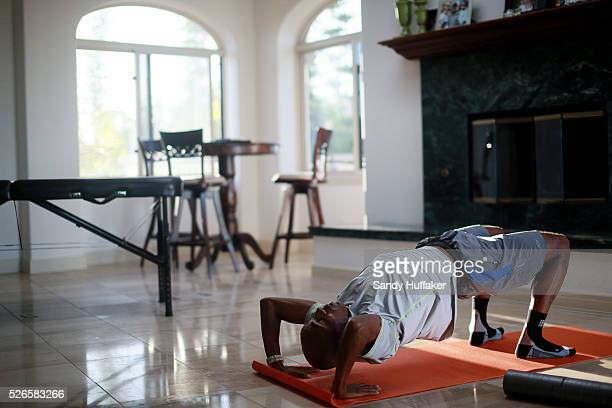 Meb Keflezighi during stretches at his home in San Diego CA on Tuesday September 16 2014 The field in New York for the Marathon will be as strong as...