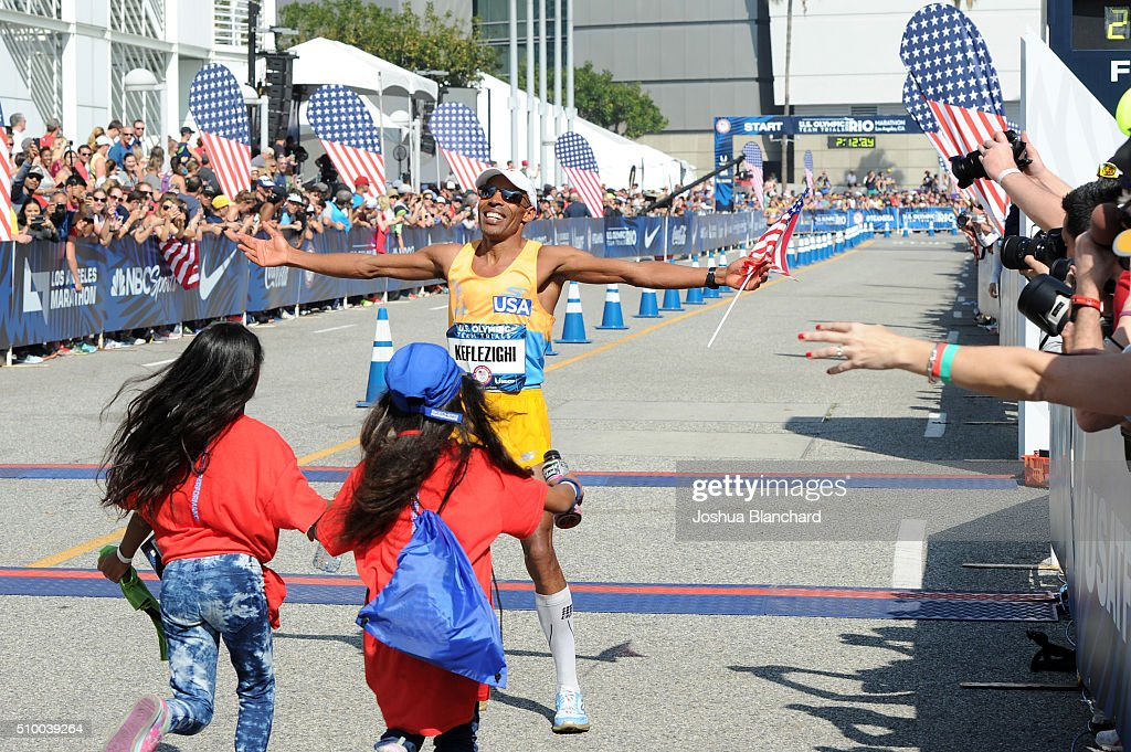 <a gi-track='captionPersonalityLinkClicked' href=/galleries/search?phrase=Meb+Keflezighi&family=editorial&specificpeople=225084 ng-click='$event.stopPropagation()'>Meb Keflezighi</a> is greeted by his family after finishing second in the U.S. Olympic Team Trials Men's Marathon on February 13, 2016 in Los Angeles, California.