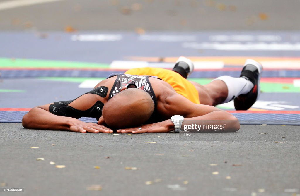 Meb Keflezighi of the United States falls to the ground after finishing his last New York City Marathon during the Professional Men's Division during the 2017 TCS New York City Marathon in Central Park on November 5, 2017 in New York City.