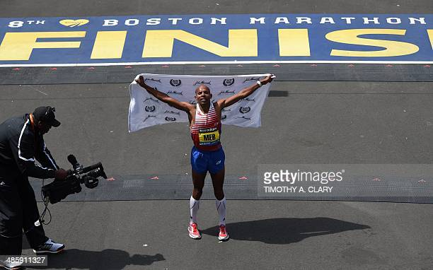 Meb Keflezighi of the US celebrates after crossing the finish line to win the Men's Elite division of the 118th Boston Marathon in Boston...