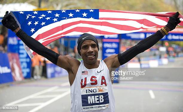 Meb Keflezighi of the US celebrates his victory in the New York City Marathon November 1 2009 in New York Keflezighi the 2004 Olympic silver medalist...
