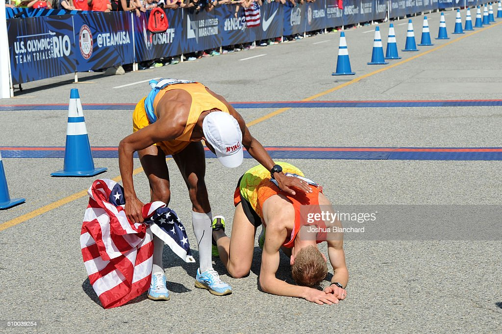 Meb Kelflezighi (L) and Jared Ward celebrate after qualifing for the Olympics at the U.S. Olympic Team Trials Men's Marathon on February 13, 2016 in Los Angeles, California.