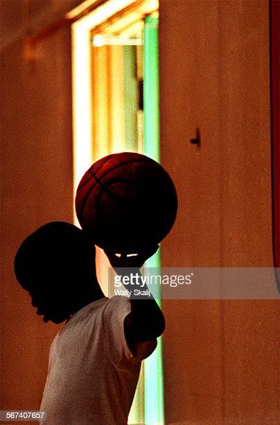 MEBasketball10813WS––Quitin Howard takes a break from a Tyus Edny basketball camp at Long Beach Poly Thursday August 13 1998 Kids from low income...
