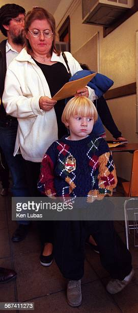 MEcampout3kl1/5/98––PASADENA––Four–year–old Christian Zwicky waits in line Monday morning with his mother Barbie Zwicky to be registered for...